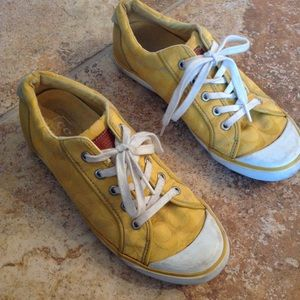 Yellow coach athletic shoes